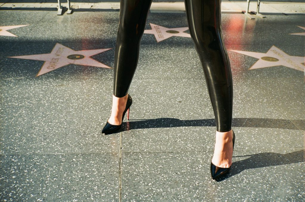 Elite Domina Iris in latex and stilettos.